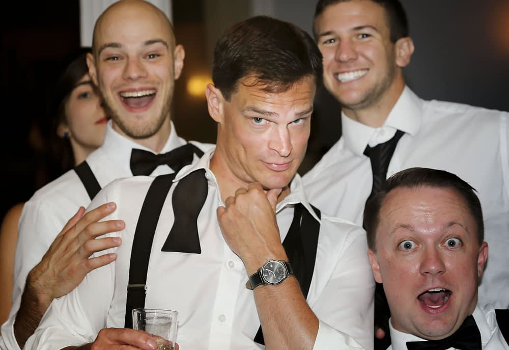 eastern shore weddings photo of men partying during reception
