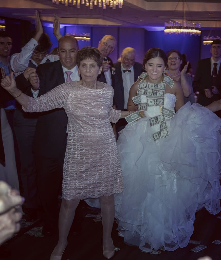 eastern shore weddings photo of bride dancing greek wedding dance during reception