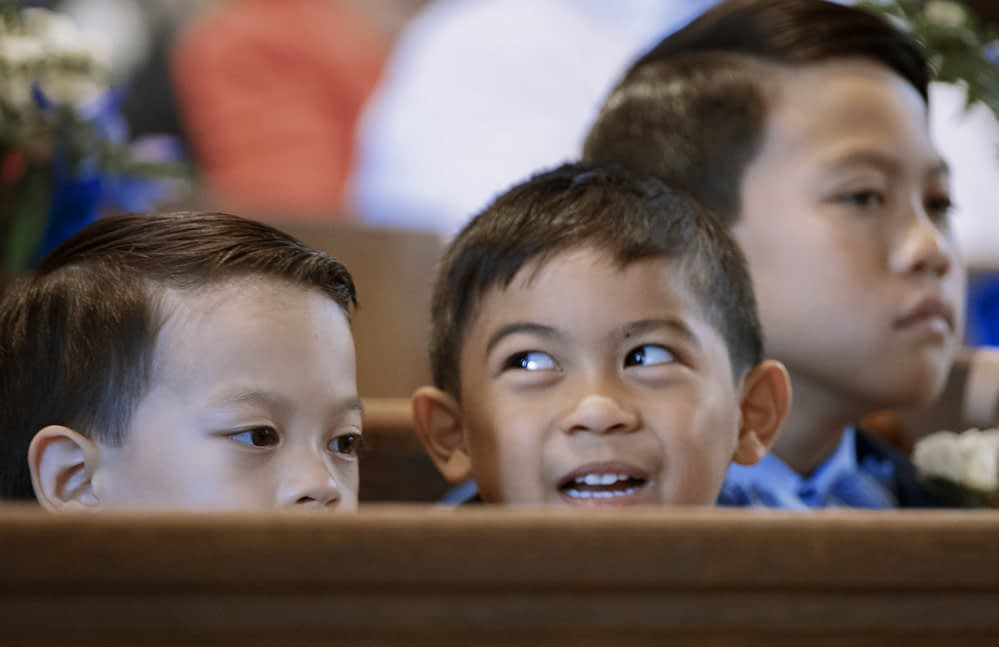 Eastern shore wedding photo of children sitting pew during church ceremony