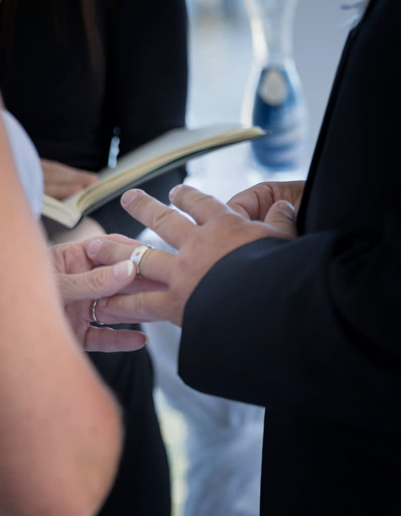 Eastern shore weddings photo of ring exchange during wedding ceremony