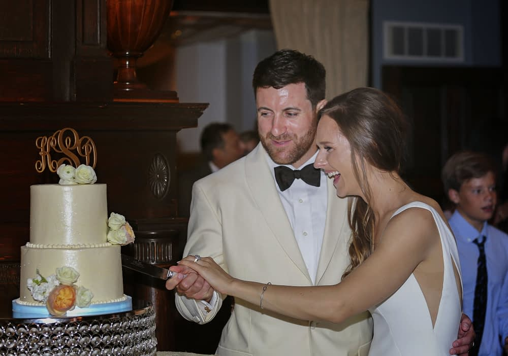 eastern shore weddings photo of couple cutting wedding cake