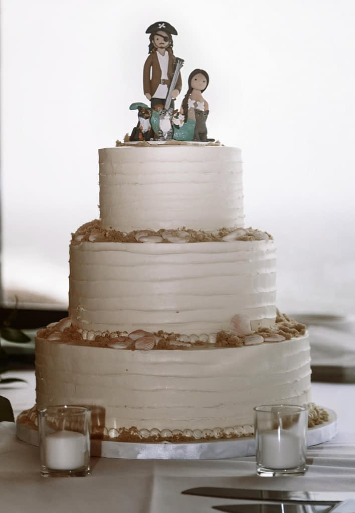 Eastern Shore Weddings photograph of wedding cake with pirate topper
