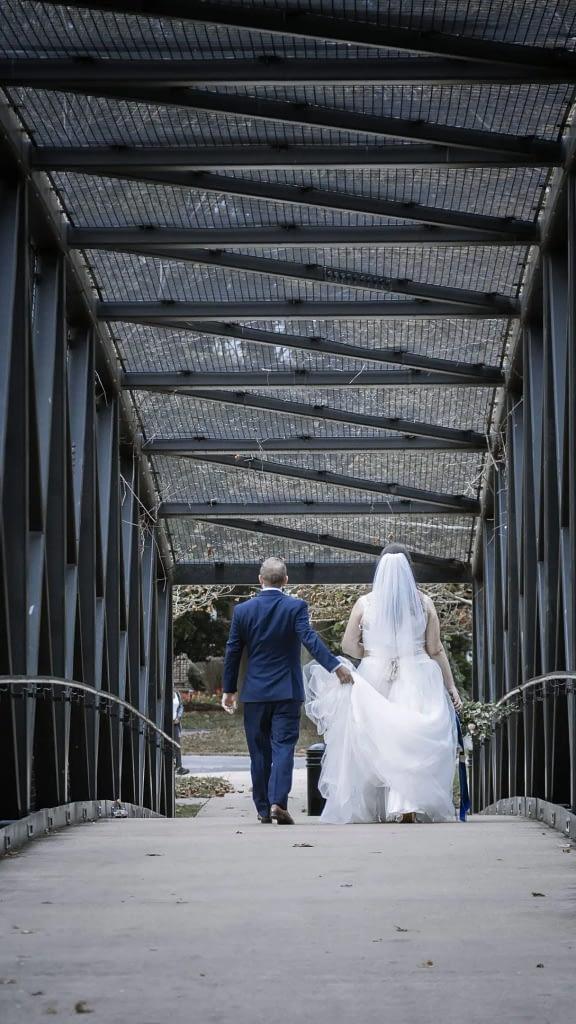 eastern shore weddings photo of couple walking across a bridge