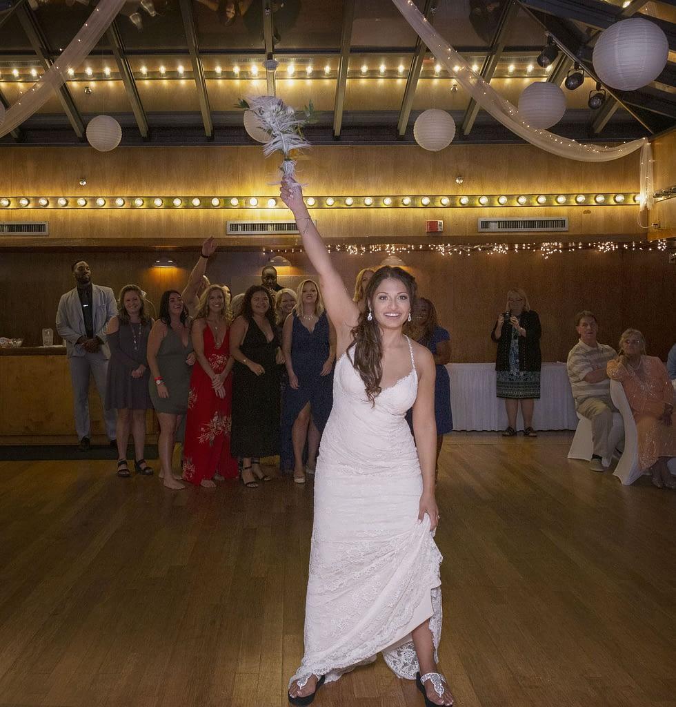 Eastern shore weddings photo of bride throwing her wedding bouquet