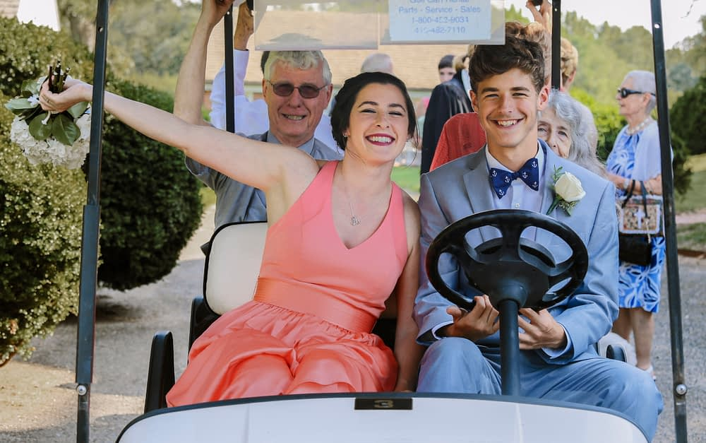 eastern shore weddings photo of bridal party traveling in golf cart