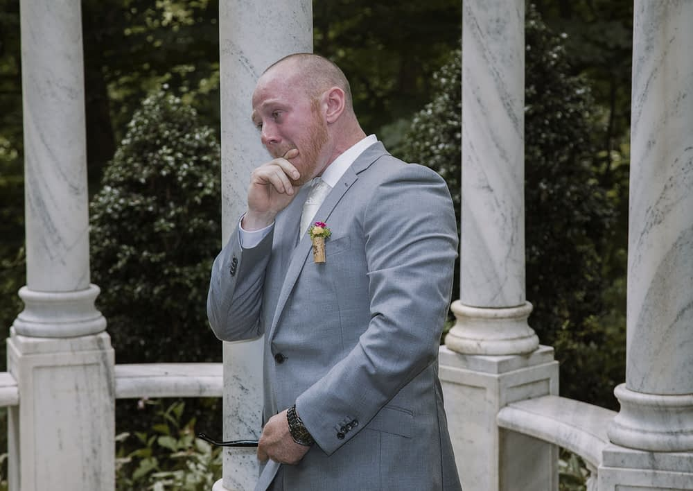 eastern shore weddings photo of groom crying during first look
