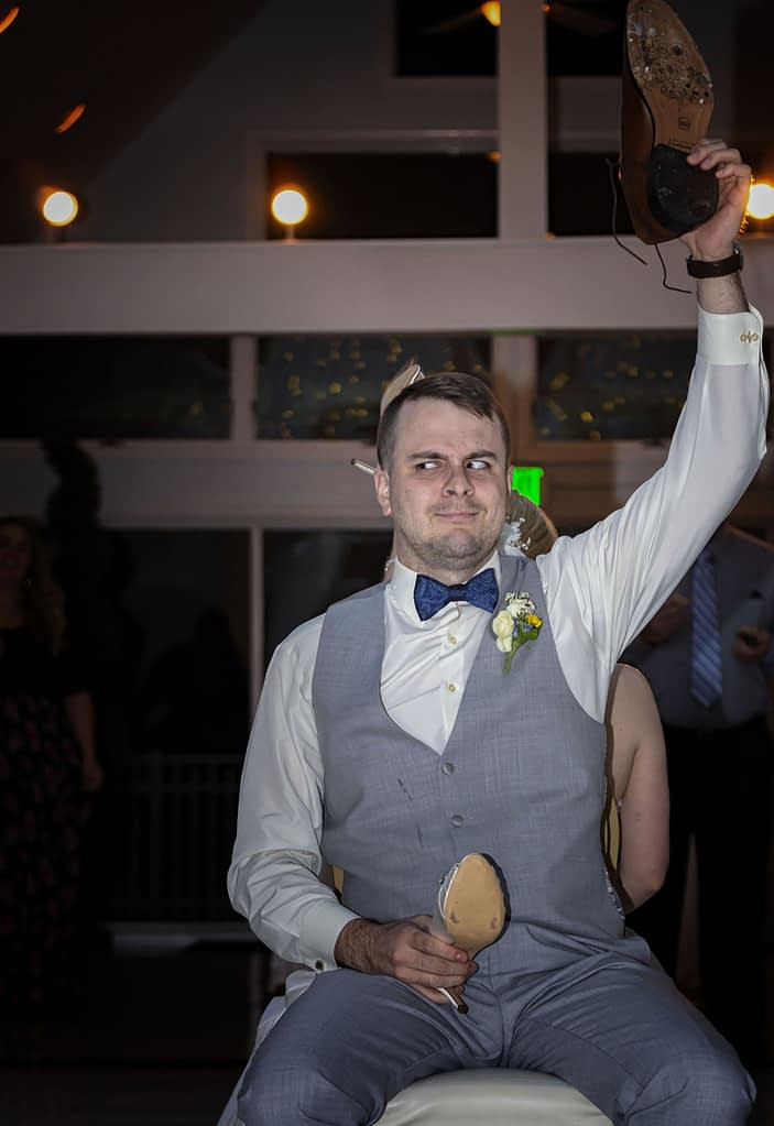 eastern shore weddings photo of groom playing game during reception