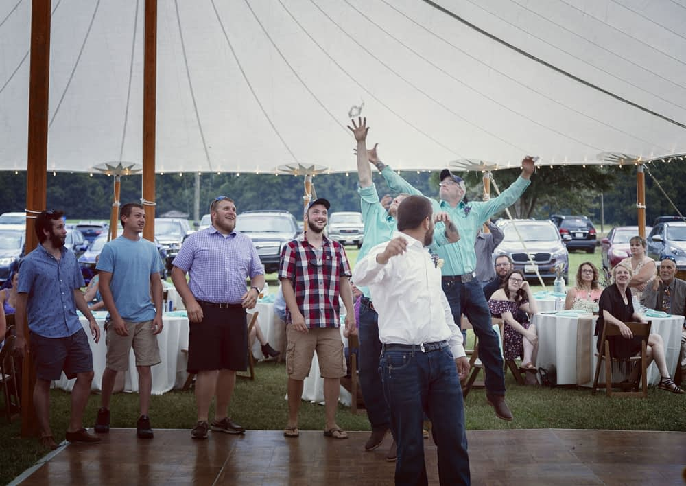 eastern shore weddings photo of garter belt toss