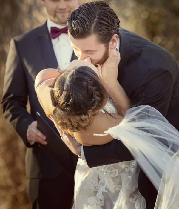 Eastern shore weddings photo photo of groom kissing bride during ceremony