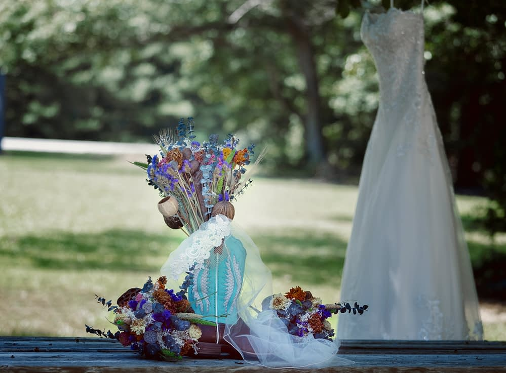 bride dress and shoes with flower boquet
