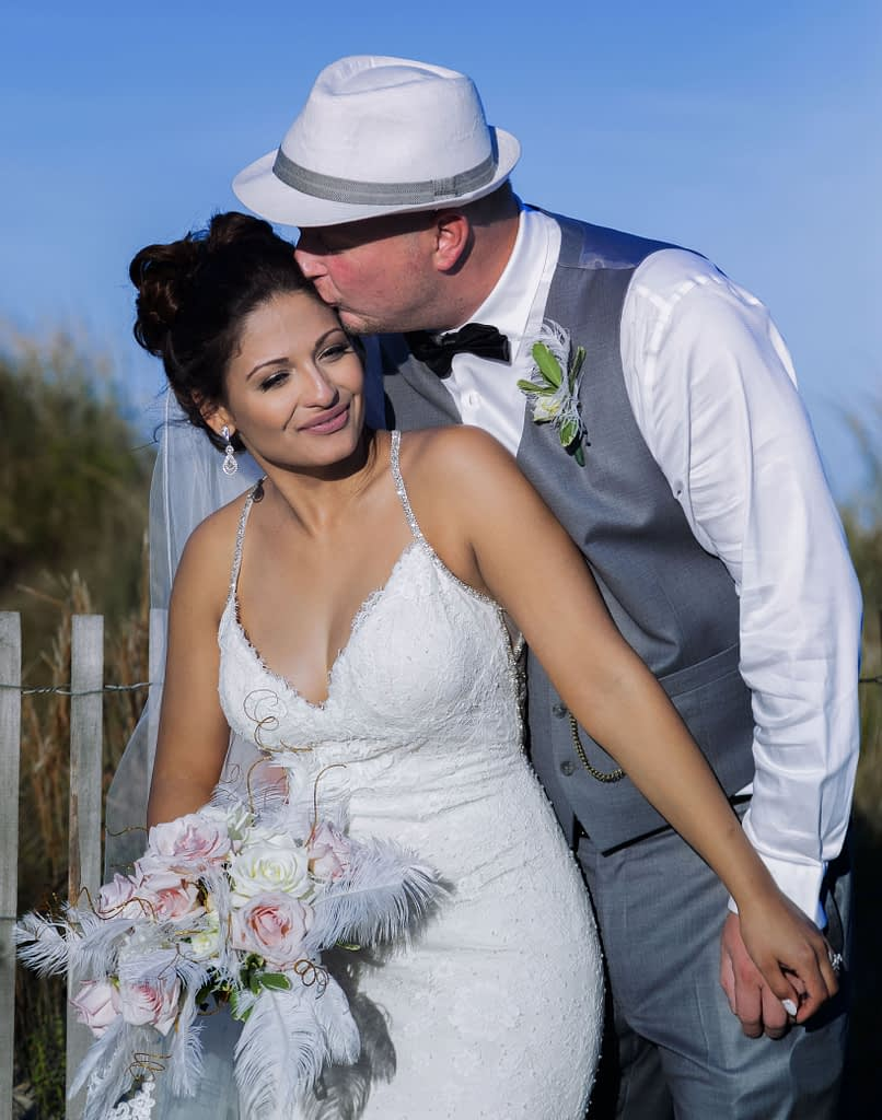 eastern shore weddings photo of bride and groom kissing on the beach